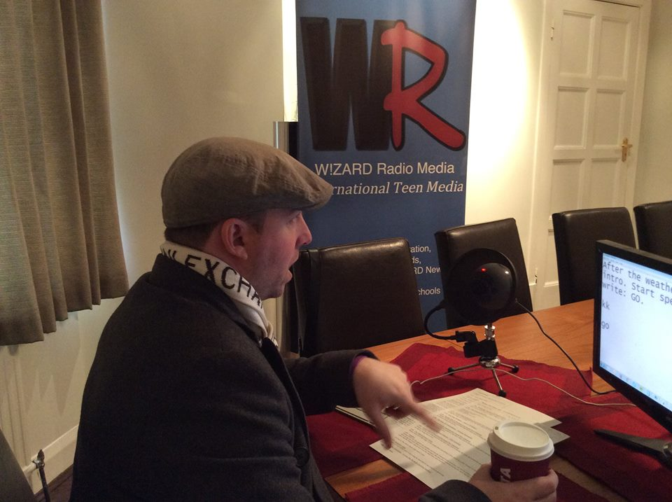 "Broadcasting his weekly radio show, ""Therapy with Thomas Mills"" at W!zard Radio studios."